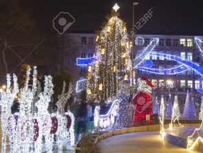 VARNA, BULGARIA - DECEMBER 19, 2015: electric snowman and tree - illuminations for Christmas and New Year holidays on the street.